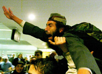 Lebanese prisoner Abdel Aziz Khodr screams to his family upon his arrival at Beirut airport January 19, 2004. Four Lebanese prisoners arrived by Red Cross chartered plane after being released by U.S. forces in Iraq.